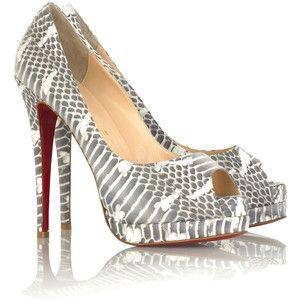 Туфлі з червоною підошвою